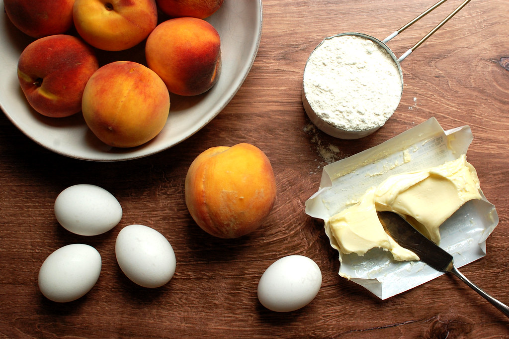 ingredients for peach cake eggs, peaches, flour, butter