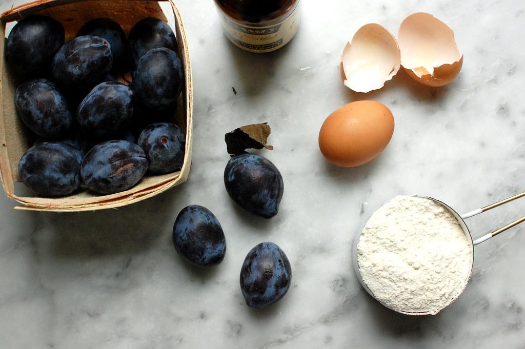 ingredients for plum cake - Italian plums, eggs, flour, sugar, vanilla