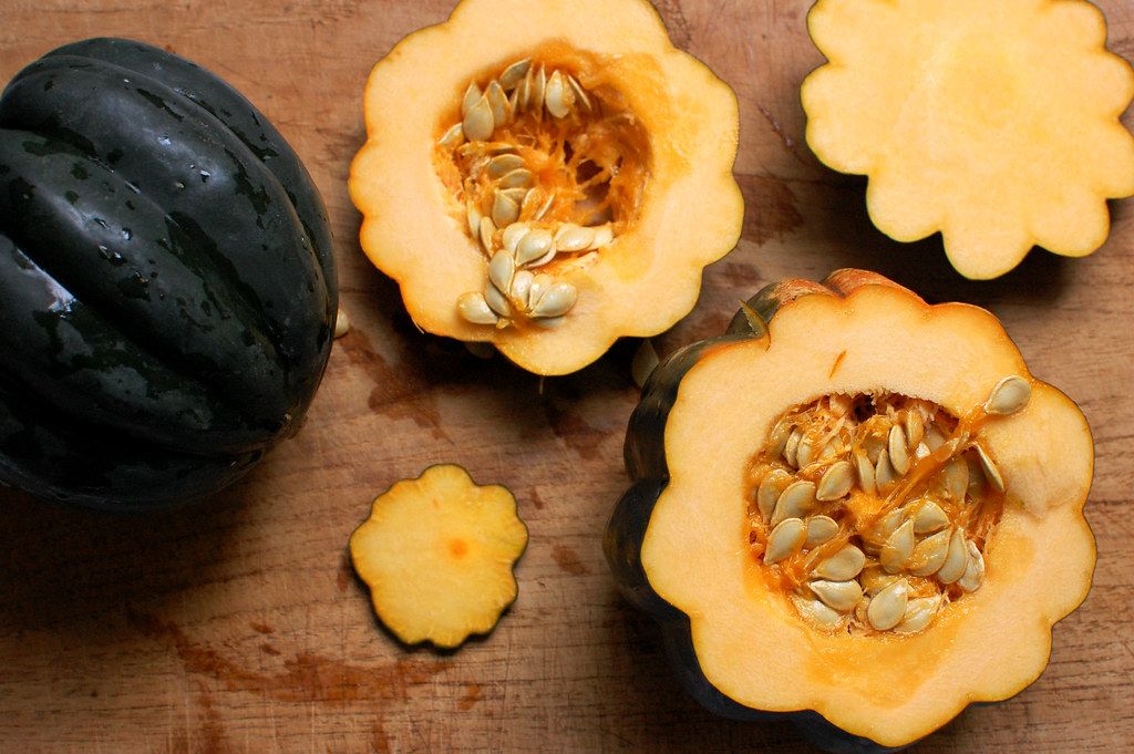 acorn squash cut open on cutting board