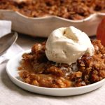 easy apple crisp with oatmeal streusel topping and vanilla ice cream
