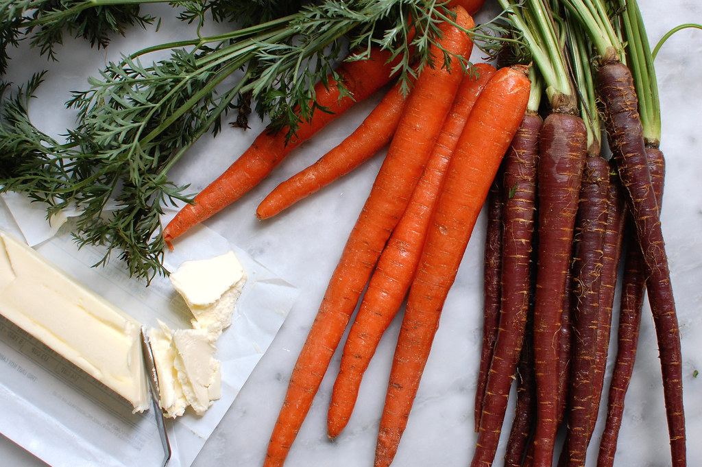 whole carrots on marble for salad